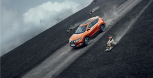 Burnt orange Nissan X-Trail