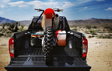 Navara carrying a dirt bike