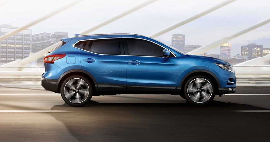 A bright blue Nissan Qashqai zipping along the highway thanks to impressive fuel economy