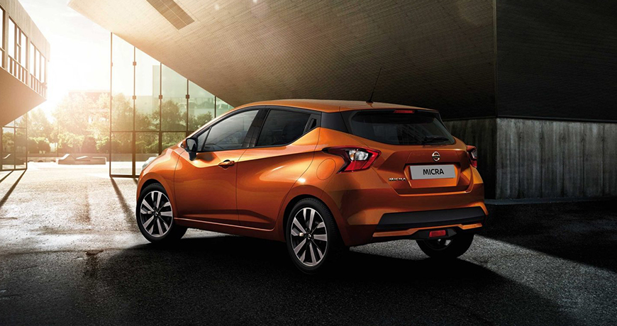 New orange Nissan Micra facing the sun - New Nissan Micra Review