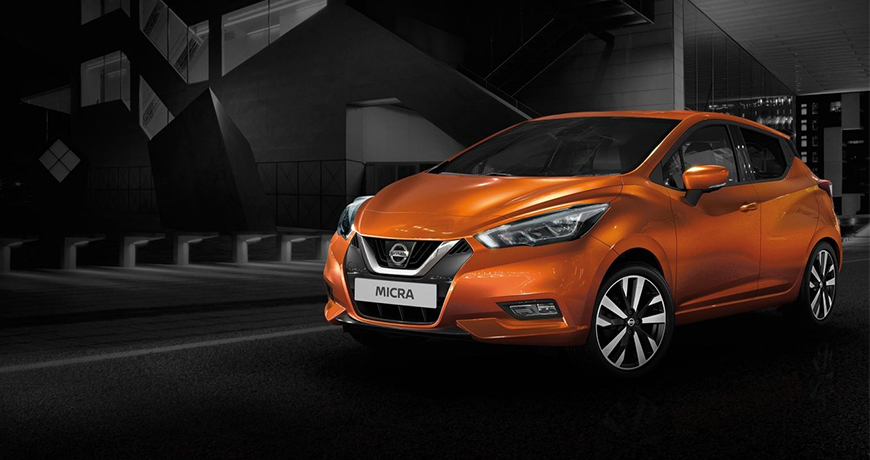 New Nissan micra in orange in a dark parking lot - review