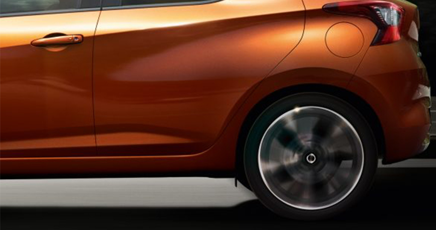 Close up of Nissan Micra spinning wheels